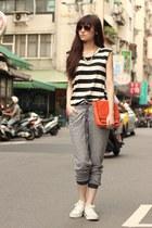carrot orange bag - heather gray pants - white sneakers - black top