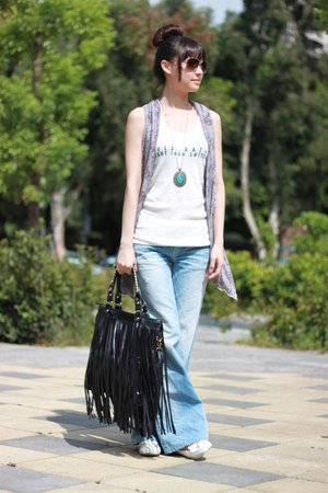 black bag - white top - light purple vest