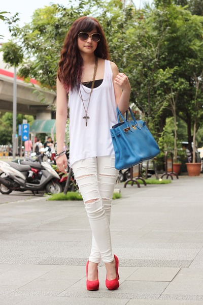 blue Hermes bag - red heels - white Zara top