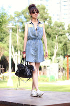 black bag - sky blue dress