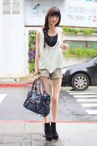 white top - black boots - navy bag - dark khaki shorts