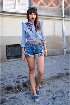 light blue Romwecom shirt