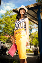 gold skirt - eggshell fedora hat - bubble gum wallet bag - top