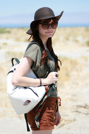 dark brown floppy felt H&M hat - tan hiking boots - white the north face bag