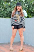 ivory knitted Zara sweater - black faux leather Zara shorts
