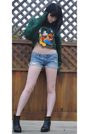 green Disney sweater
