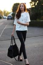 black chic heels - black biker Vero Moda jeans - white cross Poppy Lovers shirt