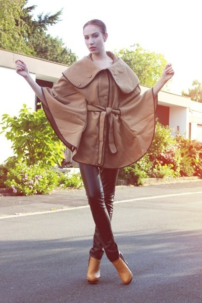 camel cape coat - black faux leather pants - mustard studded heels