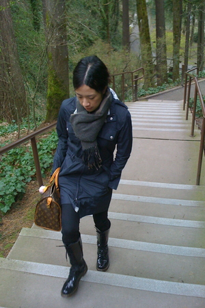 black north face jacket - black doc martens boots - brown Louis Vuitton accessor