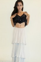 gold heart necklace - black top - silver long skirt - gold mix ring