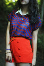 Ivory-cat-shirt-navy-shirt-red-shorts-carrot-orange-belt