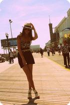 black bra - white shoes - black shorts - beige hat