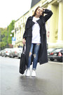 Black-front-row-shop-coat-white-adidas-sneakers