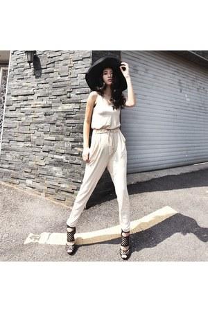 black straw hat - ivory jumpsuit jumper