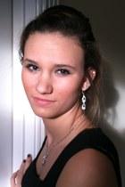 black H&M dress - diamond Napier earrings