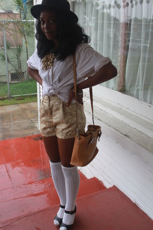 white socks socks - black hat - leather bag coach bag - gold tapestry shorts