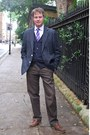 Navy-blazer-white-shirt-navy-cardigan-brown-pants-blue-tie