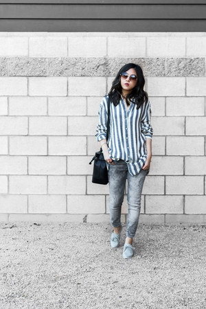 blue striped shirt - black bucket bag