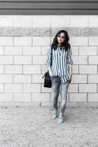 blue striped shirt - black bucket bag