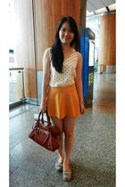 gold top - white top - tan shoes - carrot orange balenciaga bag