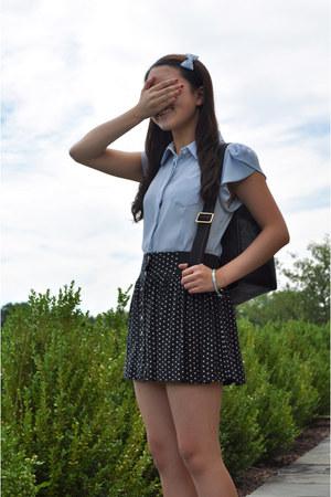black Tous bag - navy American Eagle skirt
