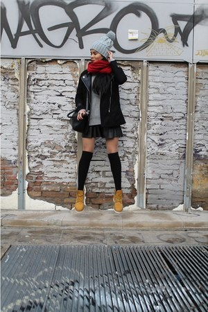 mustard boots - black jacket - silver sweater