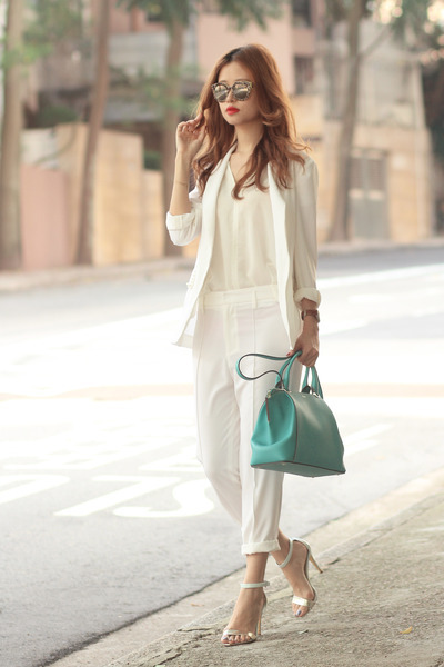turquoise blue Cartier bag - ivory Front Row Shop suit - silver ted baker heels