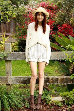beige thrift shorts