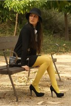 yellow tights - black dress - black hat - black heels