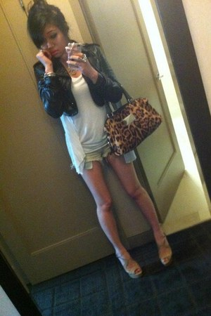 brown leopard Dolce & Gabbana bag - black leather cropped Isabella Wen jacket