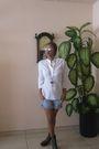 Boots-shorts-shirt-sunglasses-necklace