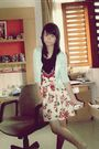 Blue-cardigan-black-t-shirt-beige-skirt-red-accessories