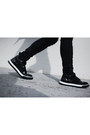 Black-sneakers-tods-shoes-white-neoprene-inter-pretus-sweater