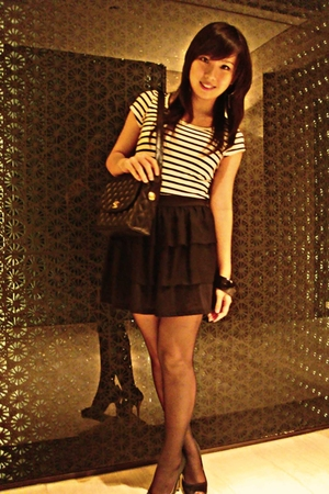 bracelet - stockings - Chanel purse - Guess black and gold heels - Gaudi  black
