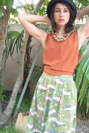 green 50s print skirt - orange 90s tank top - beige straw purse - black 90s boot