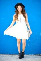 White dress...blue wall