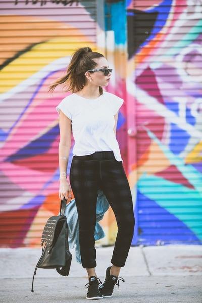 black flyknit nike sneakers - black Joes Jeans leggings - white pima doll shirt