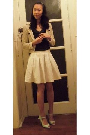 white skirt - peach cardigan - black top - green heels