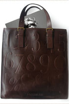 brown Assouline by Cole Haan bag