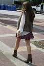 Light-brown-faux-fur-club-monaco-vest-dark-brown-zara-boots