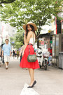 Tan-wide-brimmed-american-apparel-hat-dark-green-givenchy-bag