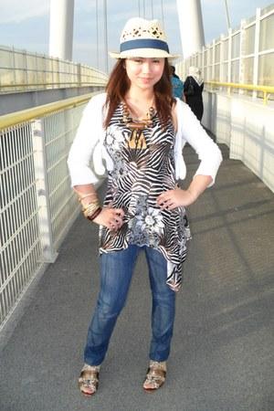 Diesel jeans - neutral H&M hat - random brand accessories - dark brown zebra pri