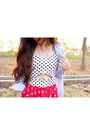 Black-floppy-hat-periwinkle-shirt-ivory-bralet-top-red-star-printed-skirt