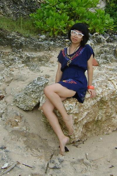 white glasses - navy Putri Bali blouse - salmon Roxy bracelet
