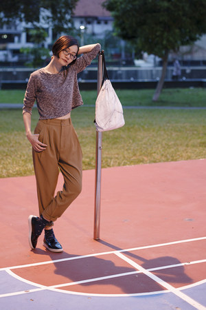 black black Zalora shoes - white marble snupped bag - light brown brown gu pants