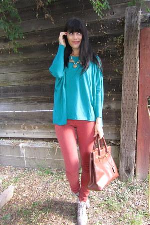 carrot orange jeans - turquoise blue sweater - bronze vintage Hermes bag