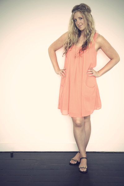 peach dress and black shoes