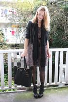 black zipper Prada bag - black buckle Dolce Vita boots