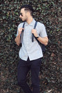 Light-blue-levis-shirt-navy-backpack-band-of-players-bag