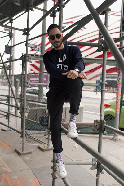 navy Lacoste sweater - black ray-ban sunglasses - black Levis pants